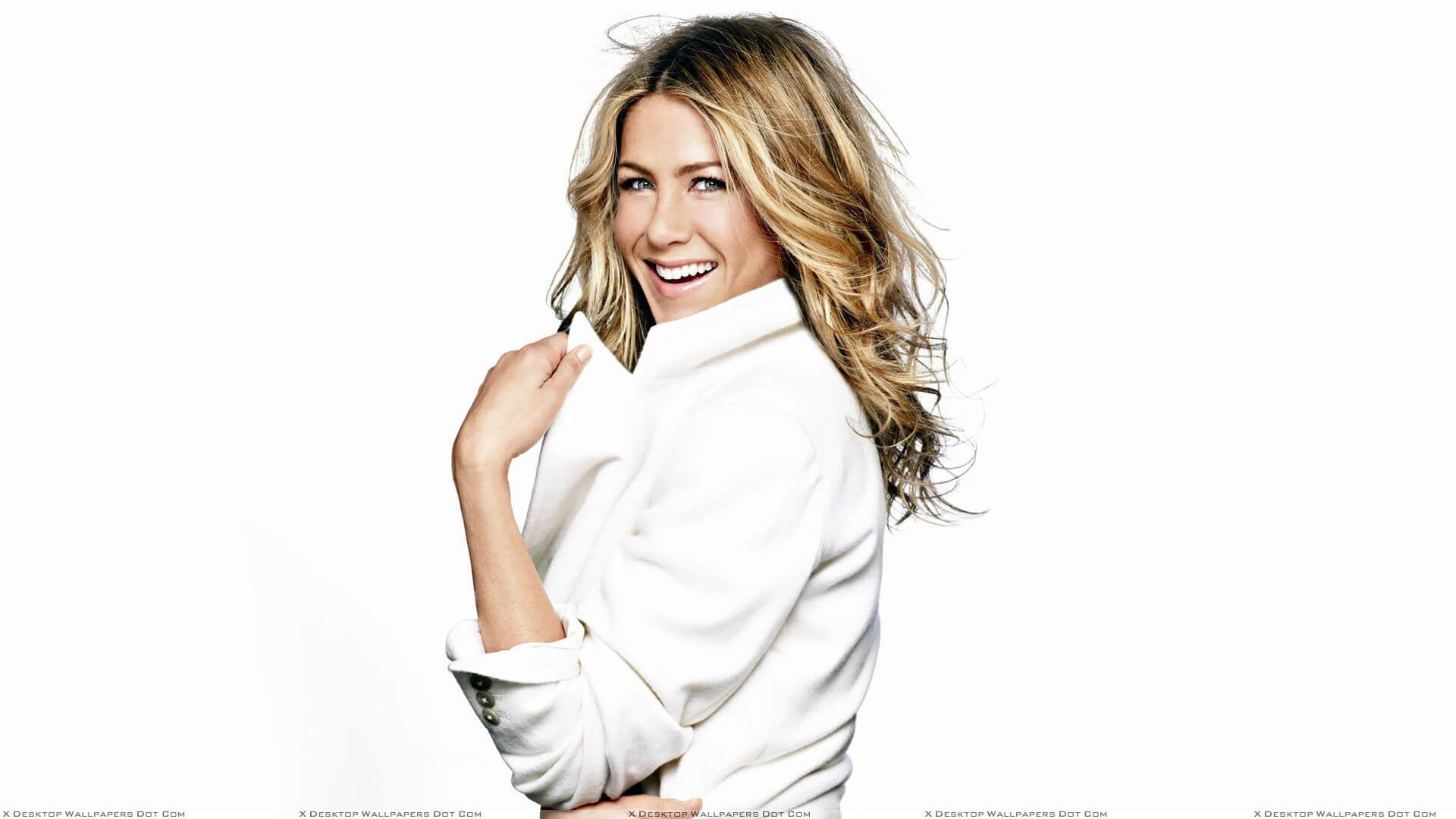 Jennifer Aniston Laughing Side Pose In White Coat N Background